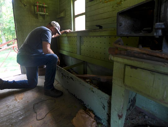 James Grantham looks inside one of the old benches