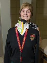 Carolyn Witte poses with the current uniform for Mercy