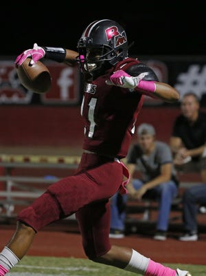 Red Mountain's Gerald Wilbon (21) celebrates a touchdown reception against Skyline during the first half at Red Mountain High School in Mesa, Ariz. on October 20, 2017.