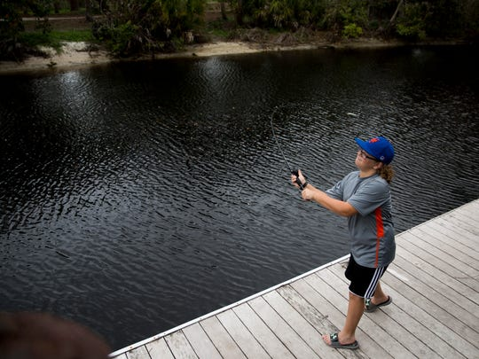"Landen Collins, 11, a fifth-grader at Pine Woods Elementary, takes advantage of having a day off school for the Presidents Day holiday as he fishes along the Imperial River at Riverside Park in Bonita Springs on Monday, Feb. 19, 2018. ""I've always loved the outdoors,"" he said while casting one of his two rods. ""I try to fish at least once a week."""