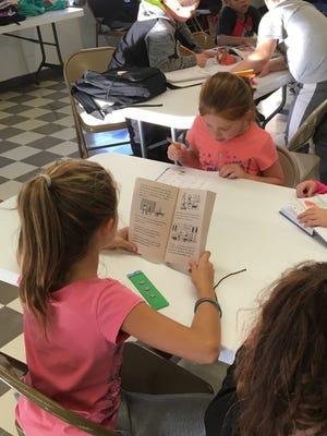Kids read and do their homework at JFK Center after-school program.