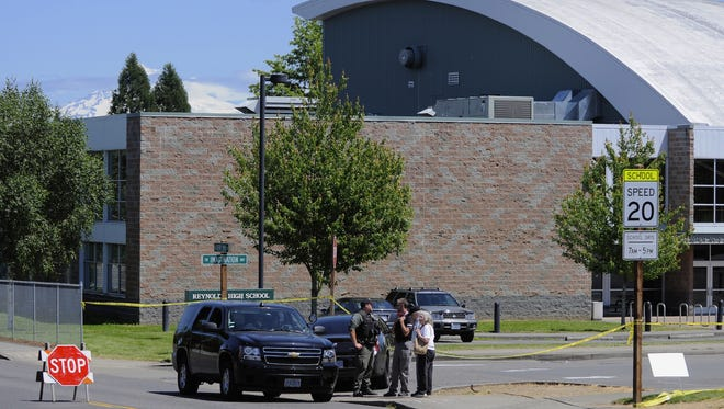 Officials work at the shooting scene at Reynolds High School in 2014.