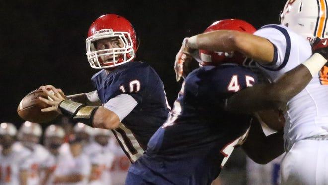 Oakland quarterback Brendan Matthews throws a pass during the Patriots 21-7 win on Friday night.