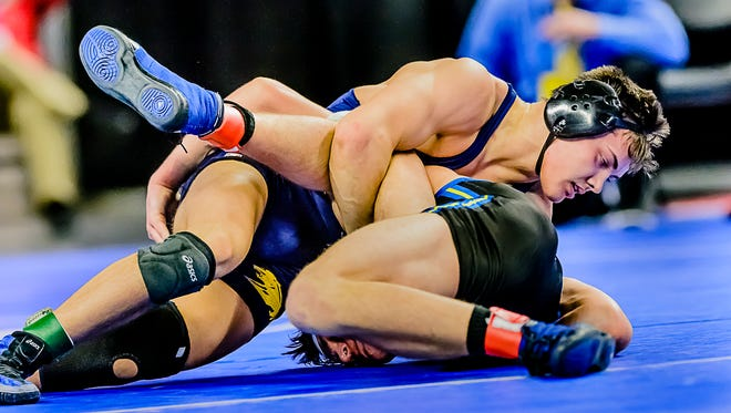 Lucas McFarland ,top, of DeWitt turns Dylan Terrence of Flint Kearsley for a near fall and 3 points in the last seconds of their 160lbs. division 2 state championship match to win 6-5.