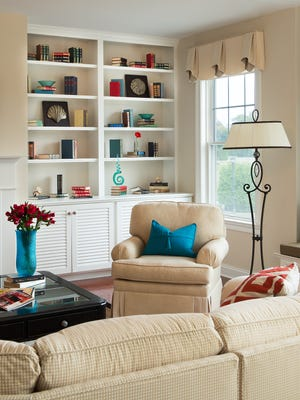 Bright accent pillows and vases provide a pop of color on neutral backgrounds.