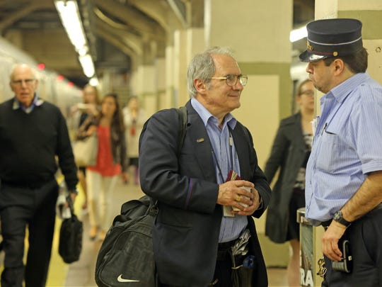 Metro North passengers check with the conductor before getting on the train at Grand Central Terminal in Manhattan on May 18, 2016.