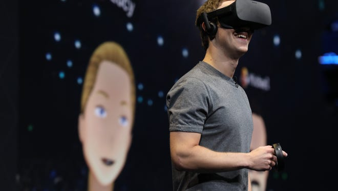 Mark Zuckerberg dons an Oculus Rift at Connect to interact in VR with two other colleagues.