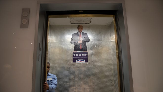 A campaign sign in an elevator at Trump Tower, where Donald Trump met with his team of advisors and the National Border Patrol Council that day, in New York, Oct. 7, 2016. Trump's campaign was teetering Saturday after the release of a video in which he speaks of women in vulgar sexual terms, with more Republican leaders calling for him to leave the ticket and demanding that the party shift focus to down-ballot races. (Stephen Crowley/The New York Times)