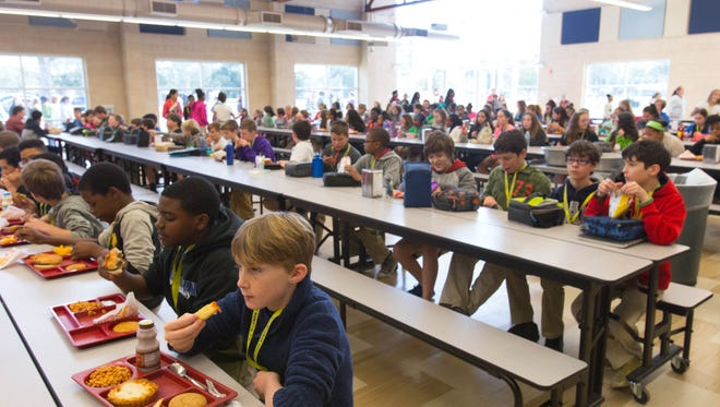 """Students at L.J. Alleman Middle School eat lunch in their newly built """"cafetorium,"""" a combination cafeteria and auditorium, in this Advertiser file photo."""