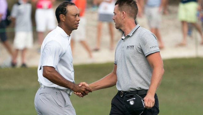 Henrik Stenson (right) was in Naples on Thursday just a week after playing with Tiger Woods in the second round of the Hero World Challenge golf tournament in the Bahamas.