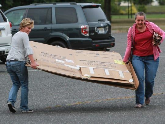 "Tinton FAlls,  NJ    Volunteers set up ""Cardboard"