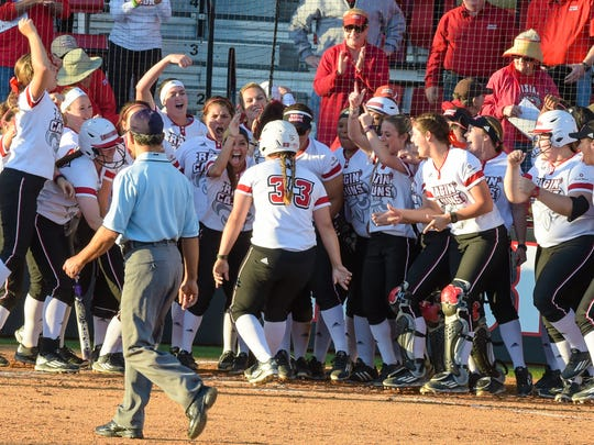 Lexie Elkins is welcomed by teamates at home plate after hitting a solo homerun. Beautiful weather out at Lamson Field as the Cajuns take on Texas Tech. Feb 25, 2016.