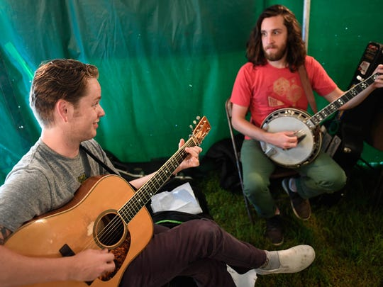 MIKE LAWRENCE / THE GLEANERBilly Strings (left) and Billy Failing with the Billy Strings Band warm up backstage at the Bluegrass in the Park/Folklife Festival in Henderson's Audubon Mill Park Friday, August 12, 2016.