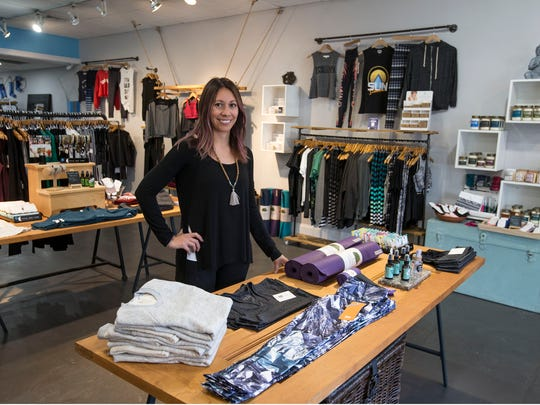 Small business owner Alison Maccione prepares her shop