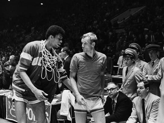 Kareem Abdul-Jabbar, then known as Lew Alcindor, talks with Purdue's Rick Mount following UCLA's 92-72 victory over the Boilermakers for the Bruins' third straight national championship on March 22, 1969 in Louisville.