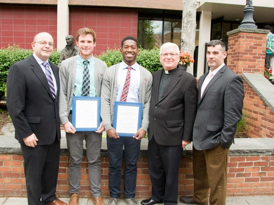 Left to right: Principal James C. DeAngelo,class of 85, Christopher Maloney, class of 16, Dakari Falconer, class of 17, President Kenneth Boller, S.J., and Dean of Student Life Anthony Locricchio, class of 96.