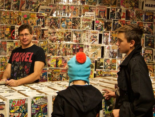 Mario Russo of Mario's Comics poses in front of a wall