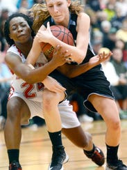 Dallastown's Alex Lehman, right, battles Dover's Alayah Hall for the ball during the YAIAA girls' tournament semifinals Tuesday. The Wildcats handed the Eagles their first loss, 53-41. (Daily Record/Sunday News -- Kate Penn).
