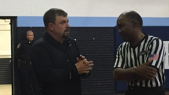 St. Amant coach Travis Uzee.