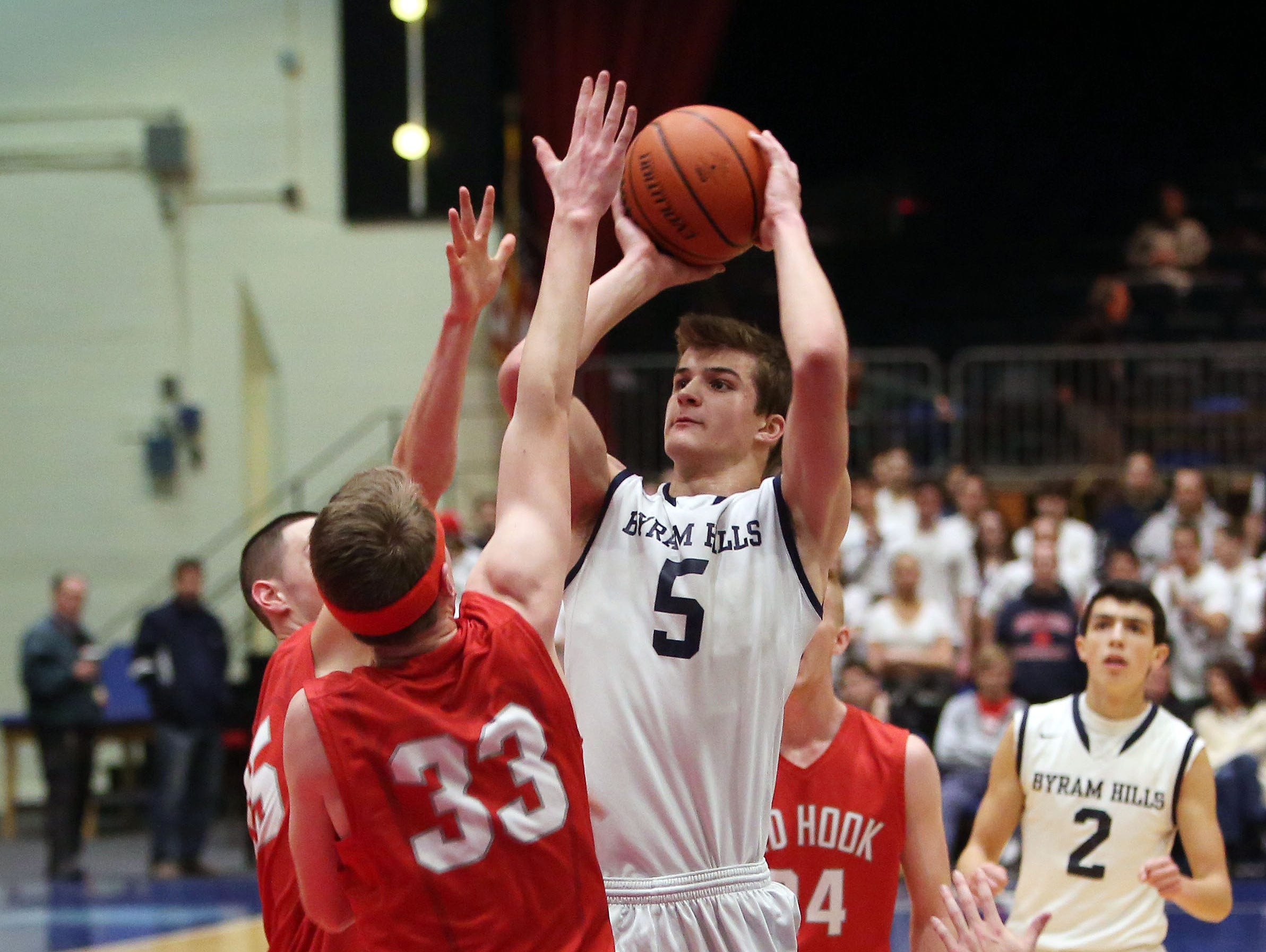 Byram Hills' Matt Groll (5) puts up a shot against Red Hook during the boys Class A basketball playoff game at the Westchester County Center in White Plains March. 1, 2016.
