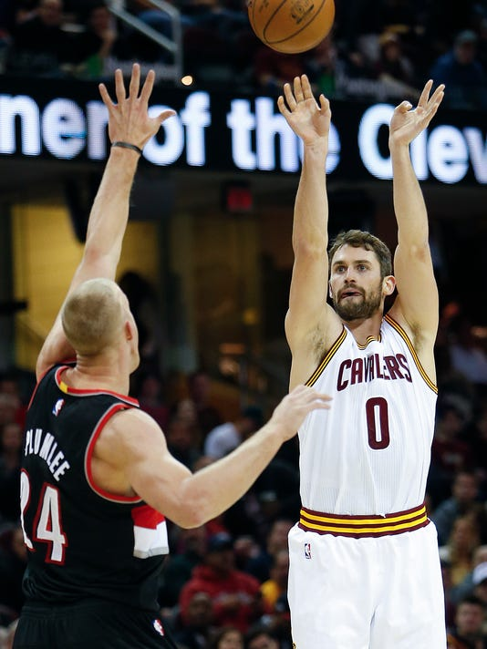 Cleveland Cavaliers' Kevin Love (0) shoots over Portland Trail Blazers' Mason Plumlee (24) during the first half of an NBA basketball game, Wednesday, Nov. 23, 2016, in Cleveland. (AP Photo/Ron Schwane)