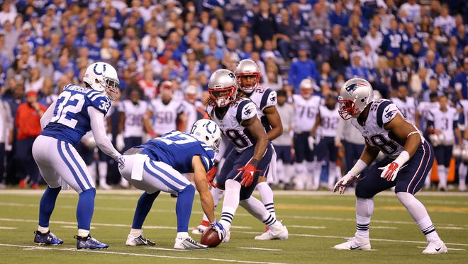 With Indianapolis Colts wide receiver Griff Whalen (17) lining up on the ball, and free safety Colt Anderson (32) preparing to take the hike, a bizarre play during second half action befuddled many on and off the field of an NFL football game Sunday, Oct. 18, 2015, at Lucas Oil Stadium.