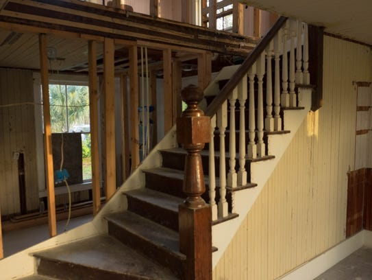 The staircase at the heart of the home is evidence
