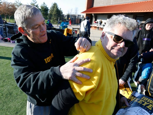 Iowa head football coach Kirk Ferentz signs the jacket