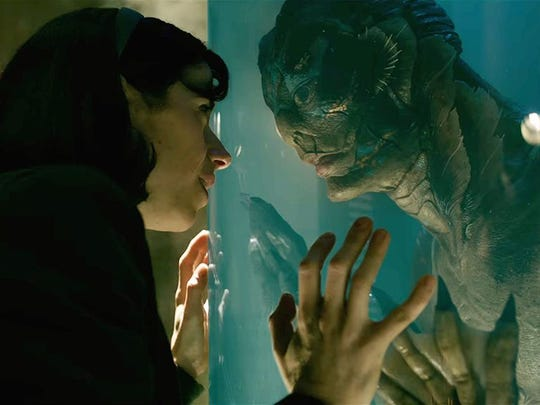 "Sally Hawkins (left) and Doug Jones (in the creature suit) connect in ""The Shape of Water."""