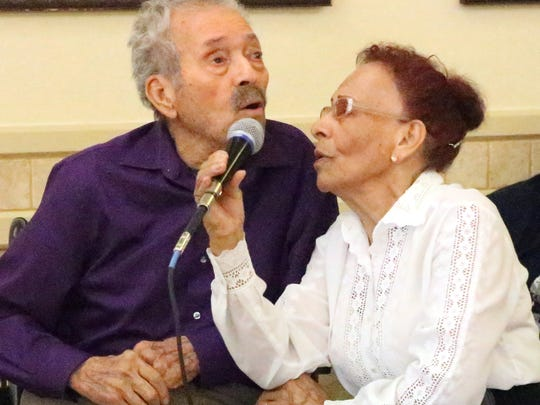 Leobardo Hernandez sings a Mariachi song with longtime friend Laura Carmona Saturday.