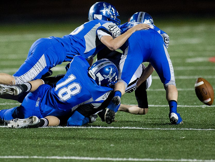 Bagdad defenders swarm a Mogollon quarterback during the Division VI high school football state championship game on Nov. 15, 2014, in Phoenix.