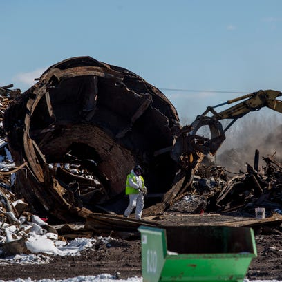 Removal of debris and scrap metal is ongoing Thursday,