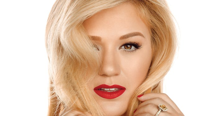 """Kelly Clarkson's """"Wrapped in Red"""" exudes the  celebratory spirit of '60s girl-group pop with the album's title track and """"Underneath the Tree."""""""