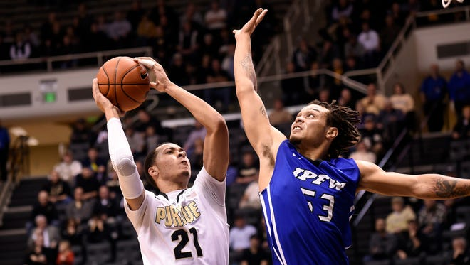Purdue Boilermakers guard Kendall Stephens (21) drives into the defense of IPFW Mastodons guard Joe Edwards (53) in the second half at Mackey Arena. Purdue defeated IPFW 63-43.