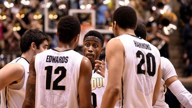 Purdue Boilermakers guard Jon Octeus (0) talks with forward Vince Edwards (12) and center A.J. Hammons (20) in the second half at Mackey Arena. Purdue defeated IPFW 63-43.