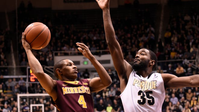 Dec 31, 2014; West Lafayette, IN, USA; Minnesota Golden Gophers guard DeAndre Mathieu (4) shoots over Purdue Boilermakers guard Rapheal Davis (35) in the first half at Mackey Arena. Mandatory Credit: Sandra Dukes-USA TODAY Sports