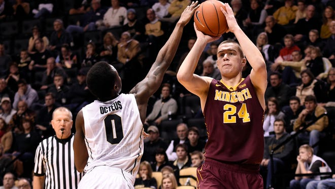 Dec 31, 2014; West Lafayette, IN, USA; Minnesota Golden Gophers forward Joey King (24) shoots over Purdue Boilermakers guard Jon Octeus (0) in the first half at Mackey Arena. Mandatory Credit: Sandra Dukes-USA TODAY Sports