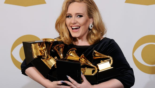 Adele cradles her Grammy Awards at the 2012 ceremony.