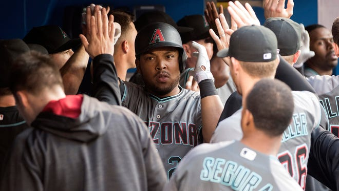Arizona Diamondbacks left fielder Yasmany Tomas celebrates his home run in the dugout during the fourth inning in a game against the Toronto Blue Jays at Rogers Centre.