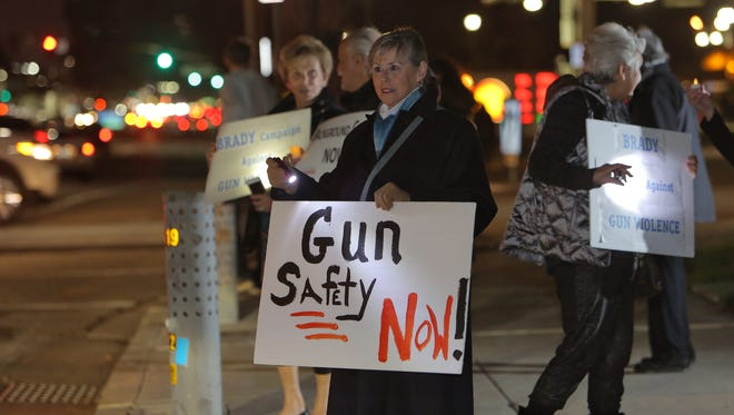 Maggie Curley, of Thousand Oaks, stands with other supporters during the rally that the Ventura County chapter of the Brady Campaign to Prevent Gun Violence held Wednesday in Westlake Village, marking the fourth anniversary of the Sandy Hook tragedy.