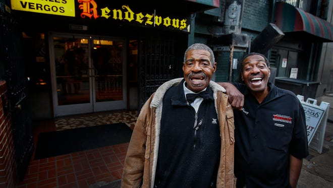 Long-time Rendezvous waiters 'Big' Robert Newman (left) and Percy Norris, who have delivered thousands of plates of barbecue to happy customers, will retire after 53 and 48 years of service. The pair - who have met numerous presidents, dignitaries, and celebrities - will hang up their barbecue-stained uniforms for last time after this year's Liberty Bowl.