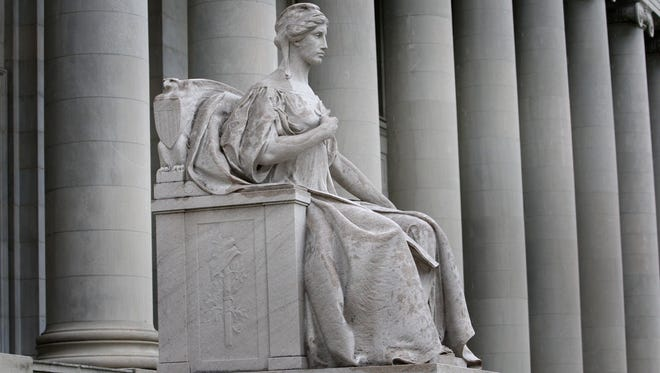 Exterior statuary at the Shelby County Courthouse includes most prominently six figures carved from single blocks of Tennessee Marble.