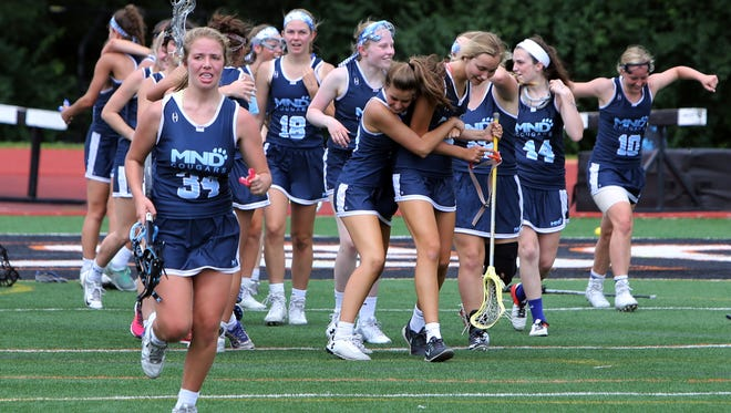 MND players celebrate as the clock hits zero. MND defeated Sycamore 18-15 to win the SW Ohio Regional Final.