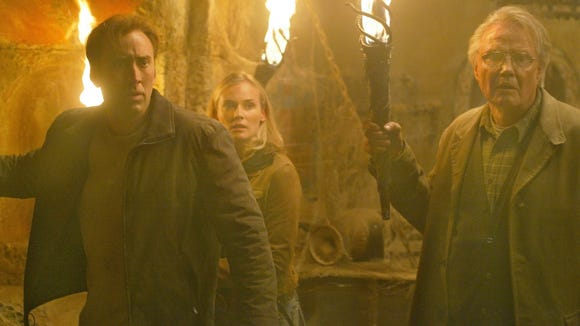 "Ben Gates (Nicolas Cage, left) teams with the alluring but unwilling National Archives conservator Dr. Abigail Chase (Diane Kruger) and his reluctant father, Patrick Gates (Jon Voight), in ""National Treasure."""