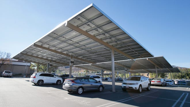 Oak Park High School's campus parking has an array of solar panels that also provide shade for cars.