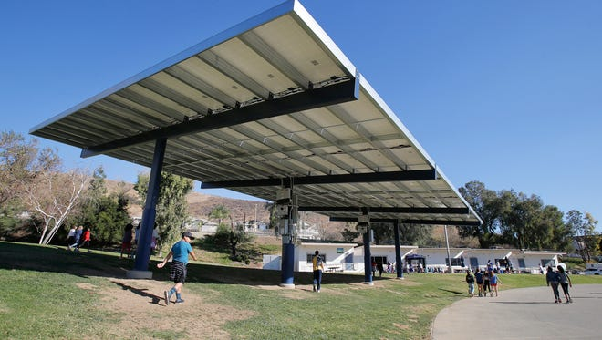 Children return to their classrooms after recess at Oak Park Elementary School. This school, along with all the others in the district, utilizes solar panels on campus. The Oak Park Unified School District was recognized for being a green school district.