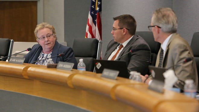 CVUSD Betsy Connolly talks to Superintendent Mark McLaughlin and board President John Andersen at a board meeting last school year.