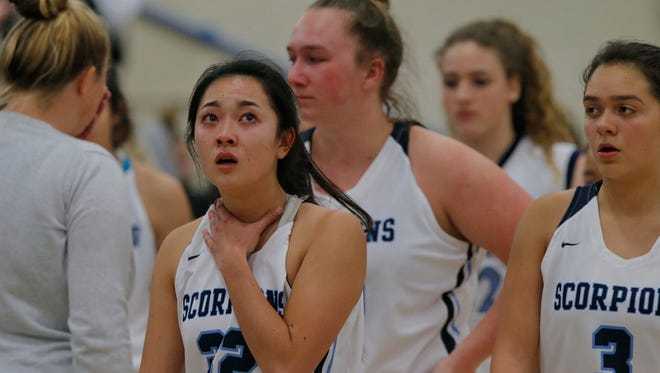 Camarillo's Marissa Hiji looks up at the final score alongside her teammates after the Scorpions lost 53-52 to Aliso Niguel in a Division 2AA quarterfinal game Wednesday night at Camarillo High.