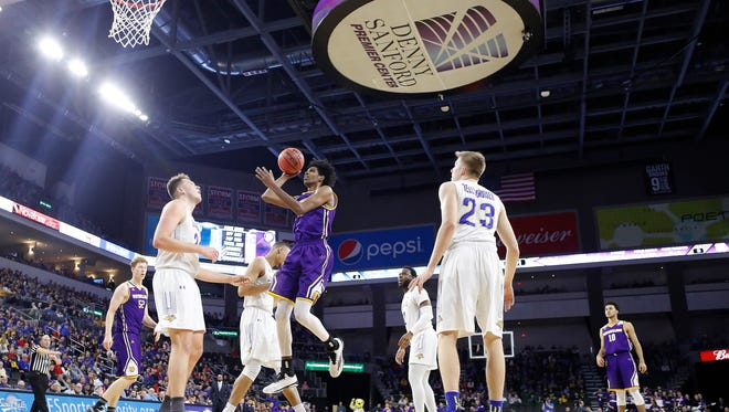 Dalan Ancrum #15 from Western Illinois pulls up on Mike Daum #24 from SDSU at the 2018 Summit League Basketball tournament at the Denny Sanford Premier Center in Sioux Falls. (Photo by Dick Carlson/Inertia)