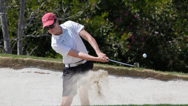 Oaks Christian's Blake McGovern hits out of the bunker on the seventh hole on the Valley Course at North Ranch Country Club during the Oak Park Invitational on Monday in Westlake Village. The sophomore is one of a slew of top players for the Lions this season.